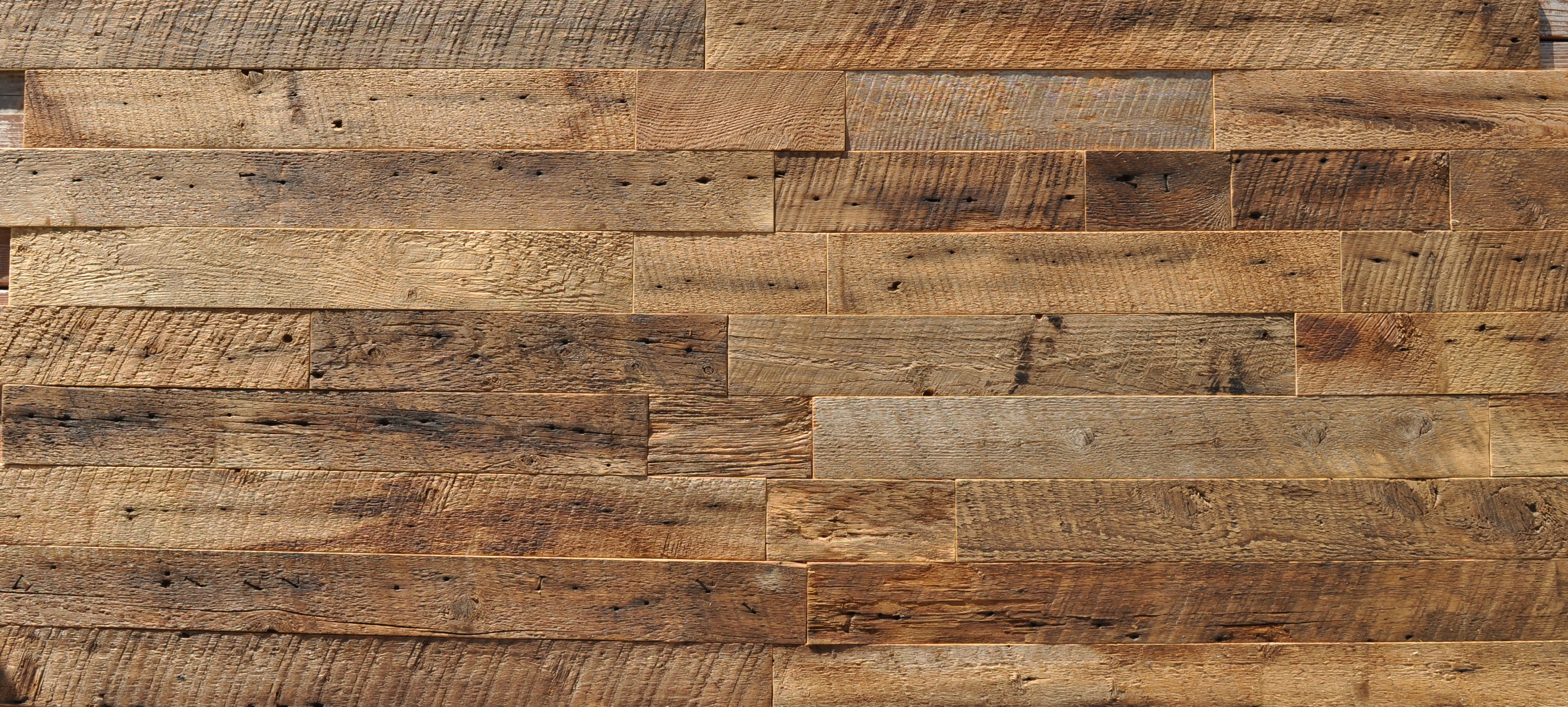 Diy reclaimed wood accent wall brown waxed and sealed 3 5 for Recycled hardwood