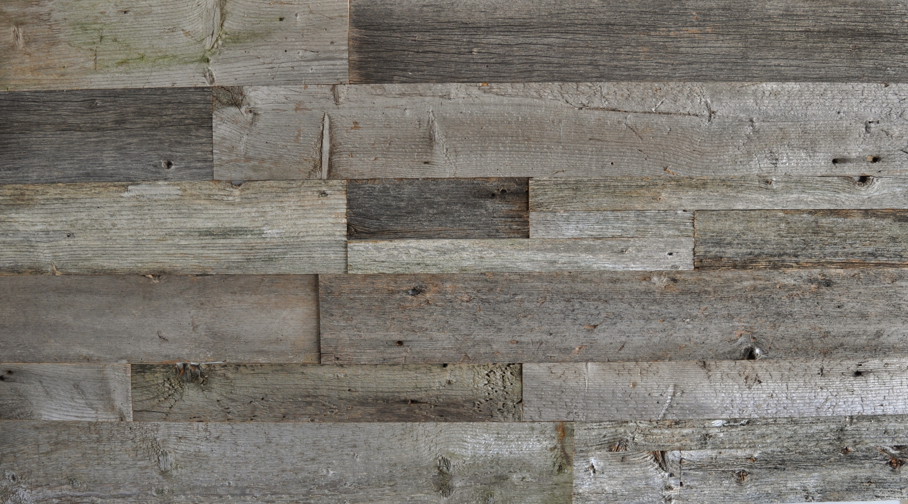 Diy reclaimed wood accent wall grey shades mixed widths for Wood wallpaper for walls